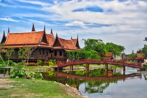 Historical Thai style houses with bridge and moat in Muang Boran in Samut Phrakan near Bangkok, Thailand