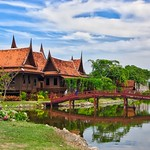 Historical Thai style houses with bridge and moat in Muang Boran in Samut Phrakan near Bangkok, Thailand thumbnail