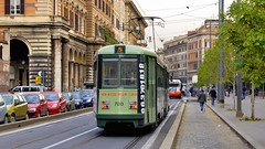 Street scene with green tram, Rome. (edk7) Tags: nikond50 edk7 2007 italy italia lazio rome roma greentram street scene car automobile vehicle train rail railway railroad rwy rr transit track pantograph architecture building oldstructure residential commercial city cityscape urban litter sidwalk curb tree wire person column arch stonecarving stonework arcade