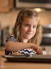 One of the nieces helps bake (mbinebrink) Tags: portrait niece girl baking bokeh nikon d750