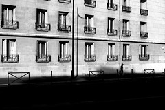 Running under windows (pascalcolin1) Tags: paris13 enfant child fenetres windows running courant ombre shadows lumière light photoderue streetview urbanarte noiretblanc blackandwhite photopascalcolin 50mm canon50mm canon