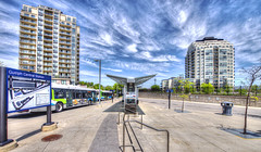 Guelph Central Station (DeZ - photolores) Tags: guelphcanada downtown 14mm busstation hdr buses buildings architecture clouds sky dez
