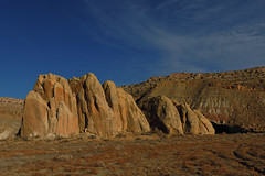 Grand Staircase Escalante - Rock Formation (Drriss & Marrionn) Tags: travel utah usa red landscape landscapes panorama mountains desert desertplains plains blue sky skies rock rockformation ridge cliff mountain grandstaircaseescalante gold soil rocks