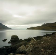 shoreline pinhole (lawatt) Tags: rock shore water fjord reykjarfjördur clouds árneshreppur westfjords iceland film 120 portra 400 hasselblad pinhole