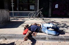 Playing dead. Brussels, September 2016. (joelschalit) Tags: brussels bruxelles belgium belge poverty europe europeanunion eu minorities migrants multiculturalism diversity discrimination drugs drunk ricohgr compactcameras streetphotography boulevardanspach