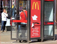 `2282 (roll the dice) Tags: london westminster w1 westend fun funny bum hoop ass bottom surreal mcdonalds food eat arrow streetphotography uk art classic urban unaware unknown people fashion trousers portrait candid stranger telephone talk phonebox canon touris tourists hot sunny weather colour glass red pants sign point blur burger