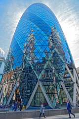 Gherkin Reflections (Geoff Henson) Tags: reflection glass windows tower skyscraper people shop sky clouds pavement sidewalk
