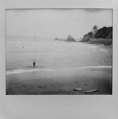 Lonely surfer (Biarritz). (miroir.photographie) Tags: spectra spectrapro polaroidpov polaroid filmisnotdead istillshootfilm argentique analog surfing surfer france biarritz