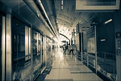 Dubai Rail (Marian Pollock) Tags: dubai rail station people reflections contrast light corridor machines curvedroof uae