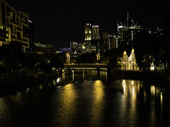 Singapore River (Thanathip Moolvong) Tags: 50mm night river skyline quay warehouse