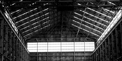 A battle between light and dark (StefanKleynhans) Tags: shelter shed factory old abandoned blackandwhite bw windows light dark white black beams contrast highlights shadows lines structure nikon d7100 50mm sydney australia nsw cockatoo island