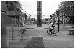 Cornering into oblivion (Nodding Pig) Tags: bristol england greatbritain uk 2017 anchorroad a4 cyclist bicycle bike reflection film scan monochrome negative 35mm ilford fp4 nikonfm2 nikkor50mmlens 20171118032101border