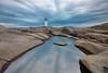 Peggy's Cove, Nova Scotia (B.E.K. Photography) Tags: peggys cove nova scotia canada longexposure sky clouds rocks water pool pond puddle reflection lighthouse outdoor landscape nikond800 nikon173528 sunset