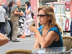 Watching the parade (Couldn't Call It Unexpected) Tags: lady woman coffee street life suglasses madrid spain