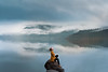 Serenity (Elizabeth Gadd) Tags: lake alouette golden ears provincial park bc canada mist fog water reflection girl woman gold yellow poncho cape beautiful sitting rock mountains calm still morning clouds small young flasher