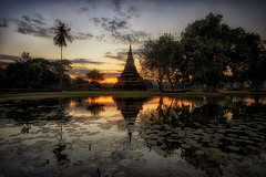 Old stupa reflecting in a pond during sunset (Davide Seddio) Tags: thailand sukhothai oldruin architecture sukhothaihistoricalpark buddhism buildingexterior cloudsky colorimage day eastasianculture famousplace nopeople outdoors photography sky templebuilding thaiculture thepast tourism tourist tradition tranquility traveldestinations vacations wat stupa water