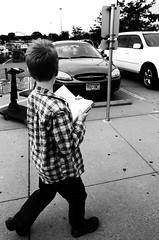 TW592: Walkin' 'n' Readin' (Thiophene_Guy) Tags: thiopheneguy originalworks nikon film fm2 ferraniap30alpha nikon24mmf28ais 24mmf28 utata:project=tw592 thursdaywalk utatathursdaywalk