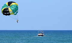 Jamaican Colours (Anthony Mark Images) Tags: people watersports water ocean caribbeansea jamaicancolours jamaica boat parasailing westindies caribbean mobay montegobay jamaicanflagcolours