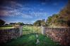 (269/18) Menorca verda (Pablo Arias) Tags: pabloarias photoshop photomatix capturenxd españa cielo nubes puerta cerca hierba campo muro menorca àrbol
