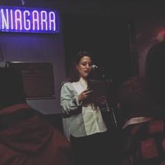 Elyssa Goodman, host of the Miss Manhattan reading series (olive witch) Tags: 2017 abeerhoque bar dec17 december fem indoors night nyc reading