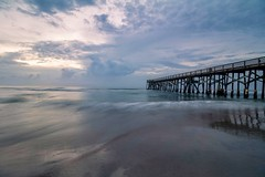 Mood (tshabazzphotography) Tags: longexposure beach sand water pier fishingpier sky waves ocean sea daytonabeach sunrise bluehour canon explore clouds cloudy low tide lowtide lonely empty magenta reflection reflective daylight daytime