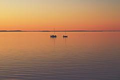 Sunset, boats and a lake (Sonnikone) Tags: tampere näsijärvi kevät auringonlasku vene purjevene vesi olympus e520 ilta evening suomi finland spring lake järvi