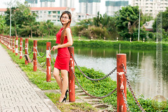 DSC_6768 (Hosting and Web Development) Tags: lake stand smile shoulder body beautiful building baluster face femininity female clothing casual column colonnade sidewalk asia arm afternoon portrait person park pavement metal curve one outdoor young woman red tree green grass eyes vertical vietnam water