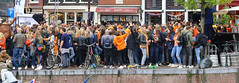 Street party on King's Day (B℮n) Tags: party boat girls boys fun dancing dance koningsdag kingsday street festival water prinsengracht orange oranje holiday willem alexander maxima amsterdam holland netherlands celebration jordaan kingdom dutch straat feest market trendy crowded free canals people floating beer amstel heineken feestdag mokum grachtengordel panden carnaval gezellig national king singing music muziek dansmuziek swing colors smoke kiss kissing kday kdag outdoor crowd 27april oranjegekte ouwejongenskrentebrood ojkb wester café 50faves topf50
