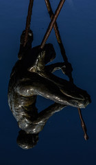 Muscular reflection (Crafty Rich) Tags: reflection statue sculpture water dark muscular
