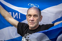 Scotland (Leanne Boulton) Tags: urban street candid portrait portraiture streetphotography candidstreetphotography candidportrait streetportrait eyecontact candideyecontact streetlife allunderonebanner auob march rally event independence indyref scottish saltire flag pride man male face eyes look emotion mood feeling blue white scottishindependence tone texture detail depthoffield bokeh naturallight outdoor light shade reportage photojournalism city scene human life living humanity society culture people politics canon canon5d 5dmkiii 70mm ef2470mmf28liiusm color colour glasgow scotland uk