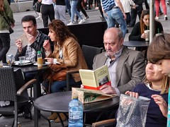 Book: On the Natural History of Destruction, Sebald. (Luis Iturmendi) Tags: people reader lector gente street streetphotography calle look mirada voyeur city urban ciudad terraza