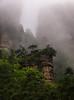 Forgotten Rock (Ash and Debris) Tags: wood rock avatar landscape high cliffs nationalpark mountains weather china clouds woods rocks cloud mist zhangjiajie nature fog asia park forest wet cliff mountain