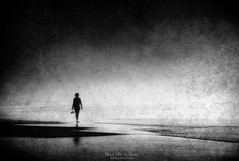 Not fear (Mimadeo) Tags: person woman girl walking silhouette lonely alone melancholia melancholy water sand shore sea black white blackandwhite active beach loneliness walk solitude lifestyle blur effect motion filter abstract art grunge grungy textures textured damaged old dirty aged