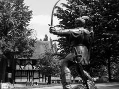 Robin Hood Statue, Nottingham (Andy Sut) Tags: trees building historicnottingham history bw blackandwhite monochrome medieval urban citycentre nottingham archer bowandarrow nottinghamcastle statue robinhood