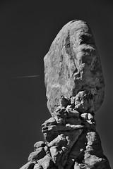 A Flight from One Side... (Black & White, Arches National Park) (thor_mark ) Tags: 128feet 128 39m archesnationalpark azimuth342 balancedrock balancedrocktrail blackwhite blueskies butte canyonlands capturenx2edited centralcanyonlands colorefexpro coloradoplateau contrail day6 desert desertlandscape desertmountainlandscape elephantbutte highdesert intermountainwest landscape layersofrock lookingnnw nature nikond800e outside portfolio project365 rockformations sunny utahhighdesert utahnationalparks2017 walkingaroundbalancedrock windowssection ut unitedstates