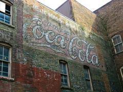 Ghost wall in Burlington, Iowa #3 (jimsawthat) Tags: smalltown burlington iowa downtown brick ghostsign vintagesign cocacola