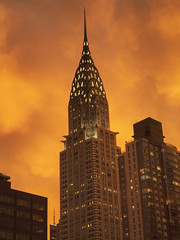 After the Rain Storm (Steven Bornholtz) Tags: chrysler building architecture buildings new york city ny nyc us usa united states america manhattan midtown weather clouds sunset orange dramatic lighting steve steven bornholtz dj midway djmidway photography imagery picture after store getolympus olympus camera ep5 pen ae