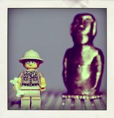 The Paleontologist on Easter Island (N.the.Kudzu) Tags: tabletop lego miniature paleontologist small easterisland statue canondslr canon50mmf18 primelens flash macro poladroid