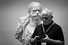 Ehm! (Roberto Spagnoli) Tags: statue observed biancoenero blackandwhite monocromo smartphone people interaction