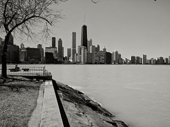 Warmth (ancientlives) Tags: chicago illinois il usa lake lakemichigan lakefronttrail olivepark skyline city cityscape skyscrapers architecture buildings towers walking downtown sepia mono monochrome blackandwhite bw april 2018 spring monday weather sunshine bluesky