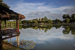 Ruin of an old stupa reflecting in a pond at the archeological site of Sukhothai (Davide Seddio) Tags: thailand sukhothai oldruin architecture sukhothaihistoricalpark buddhism buildingexterior cloudsky colorimage day eastasianculture famousplace nopeople outdoors photography sky templebuilding thaiculture thepast tourism tourist tradition tranquility traveldestinations vacations wat stupa water