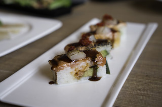 Kaka Signature Oshi Sushi - salmon, candied smoked salmon, seared scallop, spicy mayo, unagi sauce, avocado, tobiko