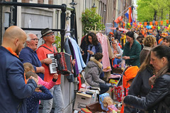 "Live accordion folk music from the most famous ""Jordaan"" district of Amsterdam (B℮n) Tags: party boat girls boys fun dancing dance koningsdag kingsday street festival water prinsengracht orange oranje holiday willem alexander maxima amsterdam holland netherlands celebration jordaan kingdom dutch straat feest market trendy crowded free canals people floating beer amstel heineken feestdag mokum grachtengordel panden carnaval gezellig national king singing music muziek dansmuziek swing colors smoke kiss kissing kday kdag outdoor crowd 27april oranjegekte accordeon life accordion folk singer"