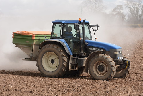 New Holland TM150 Tractor with an Amazone Z-AM 1500