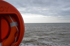 red (curly_em) Tags: hove eastsussex beach seaside sea red sky lifebuoy ring rope lifesaver
