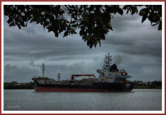 Seger 2 (agphoto100) Tags: seger boat ship cargo river brisbane wet rain lights dark clouds overcast tree leaves fuji f770exr photoshop photoscape