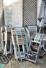 Off season (halifaxlight) Tags: england gloucestershire cirencester cafe outdoors chairs table umbrella stored patio pastels trellis