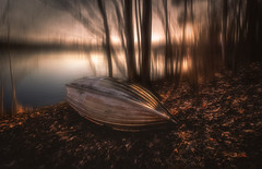 Spring and autumn (petrisalonen) Tags: trees boat leafs metsä lehdet forest river landscape sunset sunlight light nature finland vene kevät spring orange yellow slow shutterspeed autumn natural landschaft painting