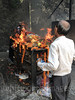 Funeral pyre (whitworth images) Tags: wood marigold ghat flowers body people person nepali mourners male cremation funeral man hindu pokhara ramghat indiansubcontinent kaski nepal firewood custom death asia fire pyre burning
