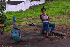Waiting (Sam Codrington) Tags: chair holidays westindies waiting seat travelphotography stvincent girl people woman younggirl art afro streetphotography caribbean arnosvale saintvincentandthegrenadines vc bench
